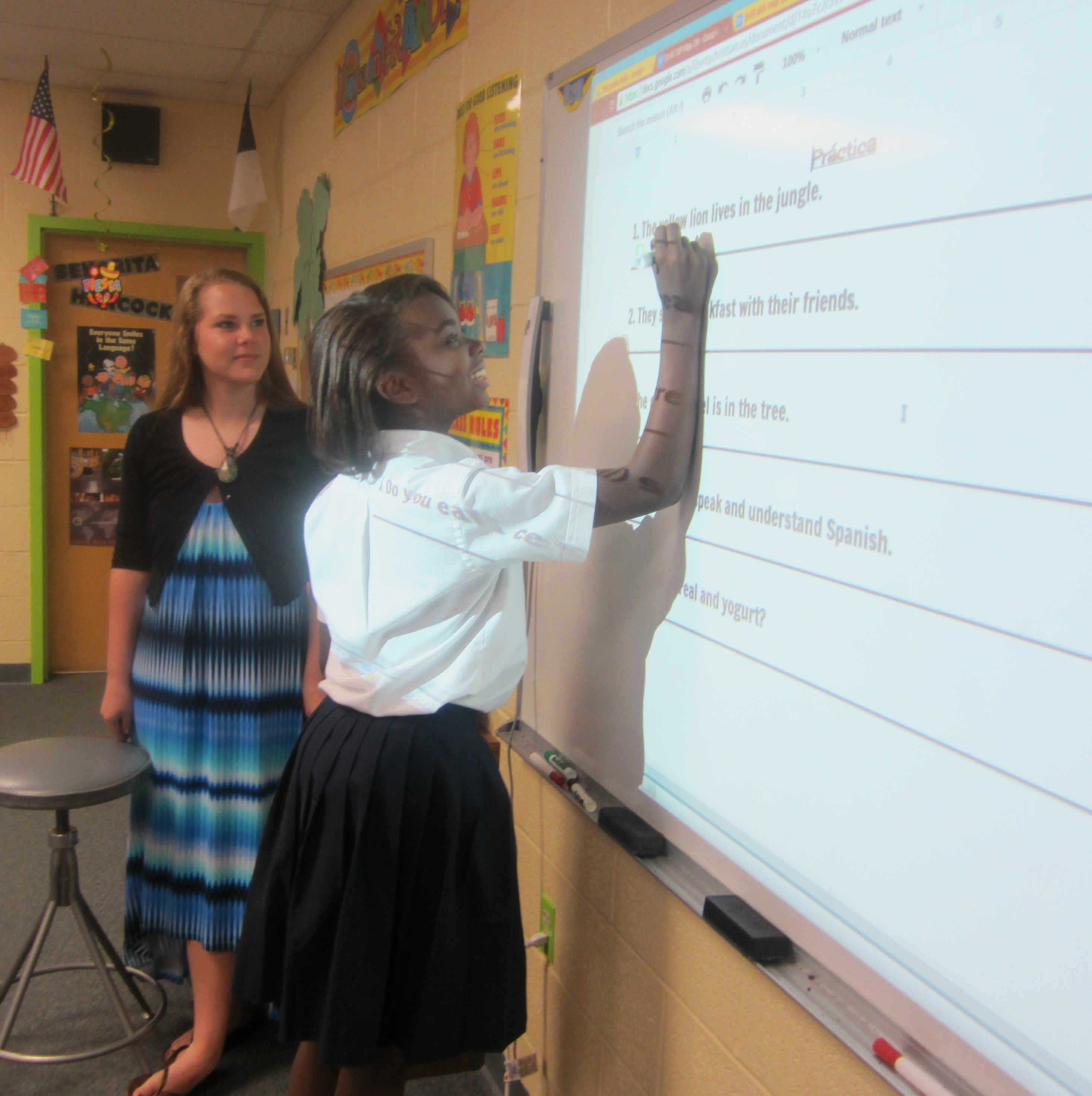 student and teacher at whiteboard