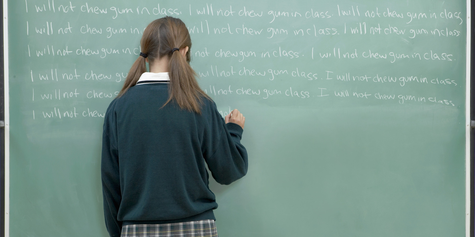 student at chalkboard