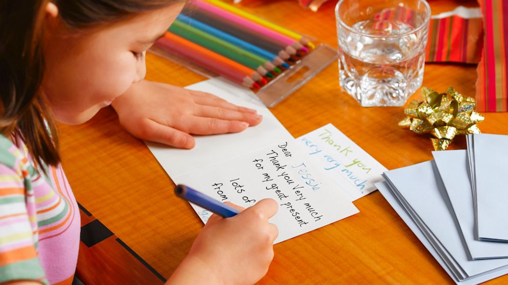 girl writing thank you note