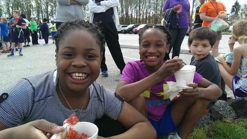 students eating snowballs