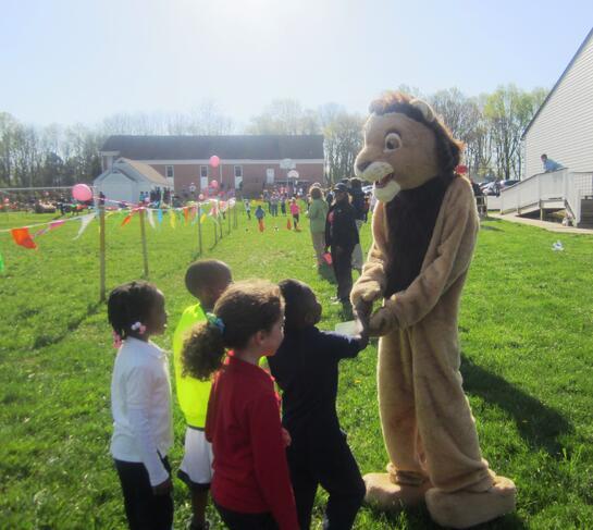 kindergarten students with school mascot