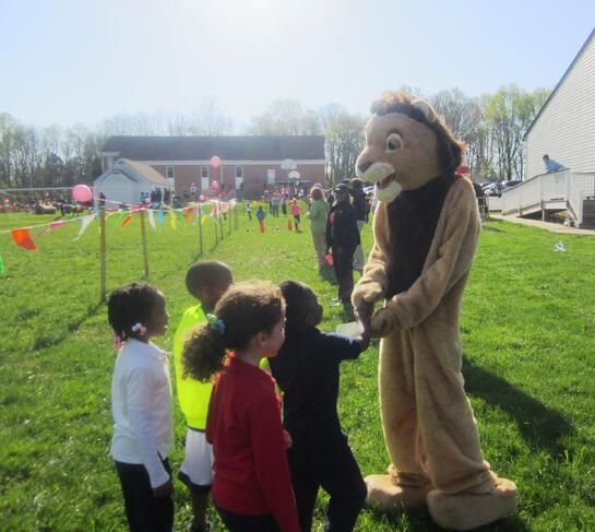 kindergarten students with school mascot