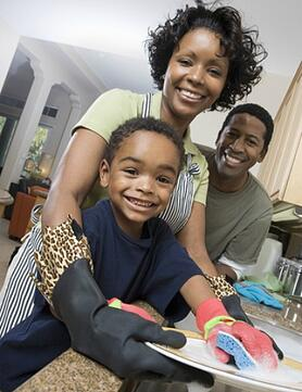 parents and child doing dishes