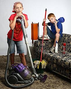 kids with vacuum and mop