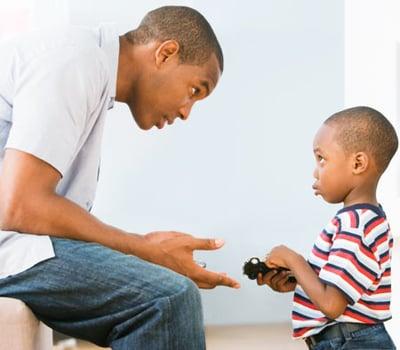 Dad disciplining child