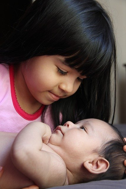 sister with baby