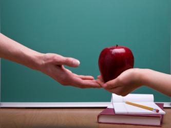 teacher receiving apple